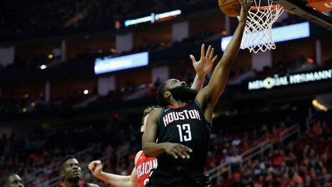 HOUSTON, TX - DECEMBER 11:  James Harden #13 of the Houston Rockets shoots a layup in the first half defended by Omer Asik #3 of the New Orleans Pelicans at Toyota Center on December 11, 2017 in Houston, Texas.  NOTE TO USER: User expressly acknowledges and agrees that, by downloading and or using this photograph, User is consenting to the terms and conditions of the Getty Images License Agreement.  (Photo by Tim Warner/Getty Images)
