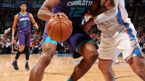 OKLAHOMA CITY, OK - DECEMBER 11: Dwight Howard #12 of the Charlotte Hornets handles the ball during the game against the Oklahoma City Thunder on December 11, 2017 at Chesapeake Energy Arena in Oklahoma City, Oklahoma. NOTE TO USER: User expressly acknowledges and agrees that, by downloading and or using this photograph, User is consenting to the terms and conditions of the Getty Images License Agreement. Mandatory Copyright Notice: Copyright 2017 NBAE (Photo by Layne Murdoch/NBAE via Getty Images)