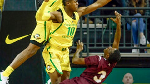 Oregon forward Kenny Wooten, top, and guard Victor Bailey Jr. jump to block the shot of Texas Southern guard Demontrae Jefferson during the second half of an NCAA college basketball game in Eugene, Ore., Monday, Dec. 11, 2017. Oregon won, 74-68. (Andy Nelson/The Register-Guard via AP)