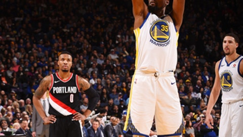 OAKLAND, CA - DECEMBER 11:   Kevin Durant #35 of the Golden State Warriors shoots the ball against the Portland Trail Blazers on December 11, 2017 at ORACLE Arena in Oakland, California. NOTE TO USER: User expressly acknowledges and agrees that, by downloading and or using this photograph, user is consenting to the terms and conditions of Getty Images License Agreement. Mandatory Copyright Notice: Copyright 2017 NBAE (Photo by Noah Graham/NBAE via Getty Images)