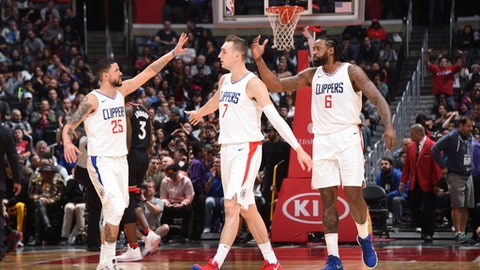 LOS ANGELES, CA - DECEMBER 11:  Austin Rivers, Sam Dekker #7 and DeAndre Jordan #6 of the LA Clippers give high fives during the game against the Toronto Raptors on December 11, 2017 at STAPLES Center in Los Angeles, California. NOTE TO USER: User expressly acknowledges and agrees that, by downloading and/or using this Photograph, user is consenting to the terms and conditions of the Getty Images License Agreement. Mandatory Copyright Notice: Copyright 2017 NBAE (Photo by Andrew D. Bernstein/NBAE via Getty Images)