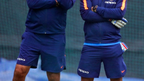 India's head coach Ravi Shastri, left, speaks to wicketkeeper Mahendra Singh Dhoni at nets during a practice session ahead of their second one-day international cricket match against Sri Lanka in Mohali, India, Tuesday, Dec. 12, 2017. (AP Photo/Altaf Qadri)