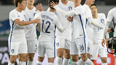 South Korea's players celebrate after their win over North Korea during their soccer match of the East Asian Championship in Tokyo, Tuesday, Dec. 12, 2017. (Kazushi Kurihara/Kyodo News via AP)