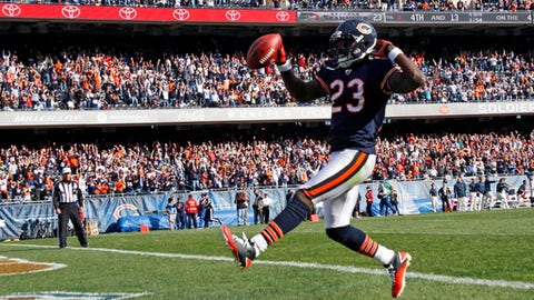FILE - In this Oct. 17, 2010, file photo, Chicago Bears wide receiver Devin Hester (23) celebrates as he scores on an 89-yard punt-return in the fourth quarter against the Seattle Seahawks, in an NFL football game in Chicago Hester, the all-purpose speedster who holds the NFL record for kick return touchdowns with 20, announced his retirement from the NFL, Tuesday, Dec. 12, 2017. . (AP Photo/Nam Y. Huh, File)