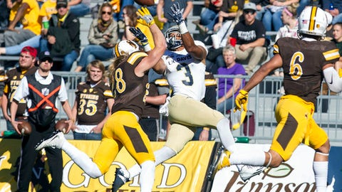 FILE - In this Sept. 17, 2016, file photo, UC Davis wide receiver Keelan Doss catches a pass while being defended by Wyoming safety Andrew Wingard during an NCAA college football game against UC Davis in Laramie, Wyo. Doss was selected for the The Associated Press FCS All-America first team on Tuesday, Dec. 12, 2017. (Hugh Carey/The Wyoming Tribune Eagle via AP, File)