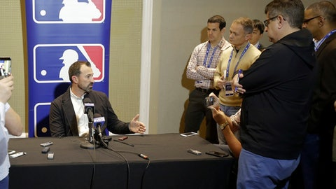 New York Mets manager Mickey Callaway, left, talks with members of the media at the MLB baseball winter meetings Tuesday, Dec. 12, 2017, in Orlando, Fla. (AP Photo/John Raoux)