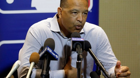 Los Angeles Dodgers manager Dave Roberts talks with members of the media at the MLB baseball winter meetings Tuesday, Dec. 12, 2017, in Orlando, Fla. (AP Photo/John Raoux)