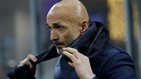 Inter Milan coach Luciano Spalletti waits for the kick-off of the Italian Cup soccer match between Inter Milan and Pordenone at the San Siro stadium in Milan, Italy, Tuesday, Dec.12, 2017. (AP Photo/Luca Bruno)