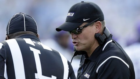 James Madison head coach Mike Houston, right, speaks with an official in the first half of an NCAA college football game against North Carolina in Chapel Hill, N.C., Saturday, Sept. 17, 2016. (AP Photo/Gerry Broome)