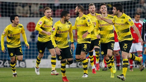 Dortmund's Sokratis, right, celebrates his side's opening goal during a German first division Bundesliga soccer match between FSV Mainz 05 and Borussia Dortmund in Mainz, Germany, Tuesday, Dec. 12, 2017.(AP Photo/Michael Probst)