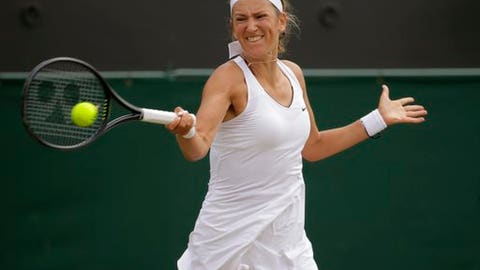 Victoria Azarenka of Belarus returns to Romania's Simona Halep during their Women's Singles Match on day seven at the Wimbledon Tennis Championships in London Monday, July 10, 2017. (AP Photo/Alastair Grant)