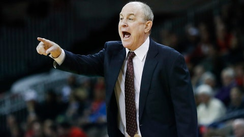 Mississippi State head coach Ben Howland directs his players from the bench in the first half of an NCAA college basketball game against Cincinnati, Tuesday, Dec. 12, 2017, in Highland Heights, Ohio. (AP Photo/John Minchillo)