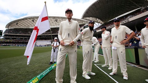 FILE - In this Dec. 3, 2017, file photo, England's captain Joe Root, center, prepares to lead his team onto the ground for the second day of their Ashes test match against Australia in Adelaide, Australia. Root's first Ashes tour as England cricket captain has been more eventful than he expected, just not in the way he had hoped. (AP Photo/Rick Rycroft, File)