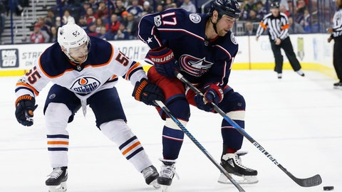 Columbus Blue Jackets' Brandon Dubinsky, right, carries the puck past Edmonton Oilers' Mark Letestu during the second period of an NHL hockey game Tuesday, Dec. 12, 2017, in Columbus, Ohio. (AP Photo/Jay LaPrete)