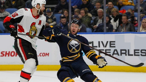 Buffalo Sabres defenseman Josh Gorges (4) and Ottawa Senators forward Zack Smith (15) collide during the second period of an NHL hockey game, Tuesday Dec. 12, 2017, in Buffalo, N.Y. (AP Photo/Jeffrey T. Barnes)