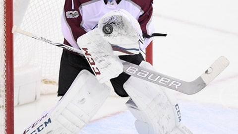 Colorado Avalanche goalie Semyon Varlamov (1), of Russia, stops the puck during the third period of an NHL hockey game against the Washington Capitals, Tuesday, Dec. 12, 2017, in Washington. The Capitals won 5-2. (AP Photo/Nick Wass)