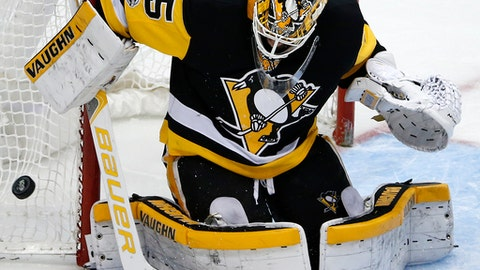 FILE - In this Dec. 2, 2017, file photo, Pittsburgh Penguins goalie Tristan Jarry (35) blocks a shot in the third period of an NHL hockey game against the Buffalo Sabres, in Pittsburgh. The Penguins are relying on a youth movement in net in their pursuit of NHL history. The two-time defending Stanley Cup champions have the youngest goalie tandem in the league in 23-year-olds Matt Murray and Tristan Jarry, who are at the forefront of a wave of young netminders making a difference.(AP Photo/Gene J. Puskar, File)