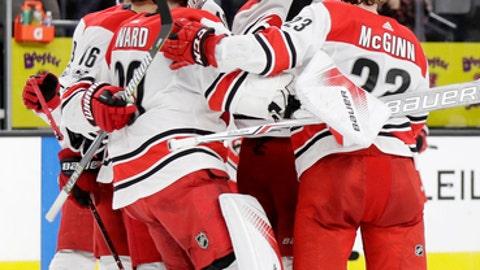Carolina Hurricanes celebrate after defeating the Vegas Golden Knights following a shootout during an NHL hockey game Tuesday, Dec. 12, 2017, in Las Vegas. (AP Photo/Isaac Brekken)