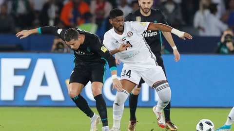 Real Madrid's Cristiano Ronaldo, left, challenge for the ball with Al Jazira's Eissa Mohamed during the Club World Cup semifinal soccer match between Real Madrid and Al Jazira Club at Zayed sport city in Abu Dhabi, United Arab Emirates, Wednesday, Dec. 13, 2017. (AP Photo/Hassan Ammar)