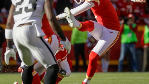 FILE - In this Dec. 10, 2017, file photo, Kansas City Chiefs kicker Harrison Butker (7) kicks a 53-yard field goal behind Oakland Raiders cornerback Dexter McDonald (23) during the first half of an NFL football game in Kansas City, Mo. Butker has never kicked 28 field goals in a season. He has that many for the Chiefs, even though he hasn't spent the entire season with them. Good for him. Not so good for a team that keeps struggling to score touchdowns. (AP Photo/Charlie Riedel, File)