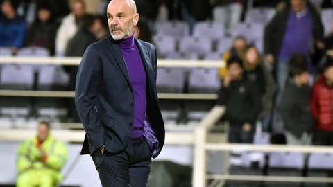 Fiorentina coach Stefano Pioli follows the Italian Cup soccer match between Fiorentina and Sampdoria at the Artemio Franchi stadium in Florence, Italy, Wednesday, Dec. 13, 2017. (Maurizio Degl'Innocenti/ANSA via AP)
