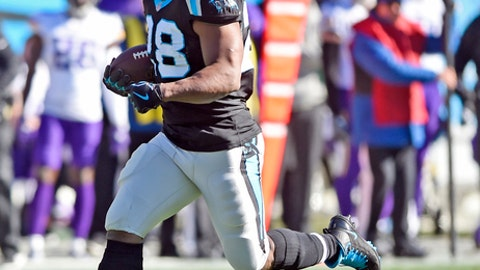 FILE - In this Sunday, Dec. 10, 2017, file photo, Carolina Panthers' Jonathan Stewart runs for a touchdown against the Minnesota Vikings during the first half of an NFL football game in Charlotte, N.C. After a slow start to the season, the 30-year-old running back is starting to heat up after rushing for 103 yards and three touchdowns in a win Sunday against the Vikings. (AP Photo/Mike McCarn, File)