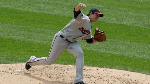 Minnesota Twins starter Anthony Swarzak throws during the second inning of a baseball game against the Chicago White Sox, Sunday, July 10, 2011, in Chicago. (AP Photo/Nam Y. Huh)