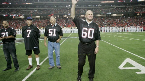Former Atlanta Falcons Pro Bowler Tommy Nobis (60), the first player ever drafted by the franchise, is introduced along with other members of the 1966 inaugural team during half time of their NFL football game against the Carolina Panthers, Sunday, Sept. 20, 2009, in Atlanta. (AP Photo/John Amis)