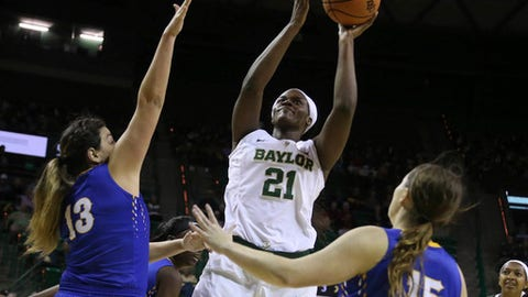 Baylor center Kalani Brown, center, scores past McNeese State center Cinthya Rivas, left, and guard Gabby Guidry, right, in the first half of an NCAA college basketball game, Wednesday, Dec. 13, 2017, in Waco, Texas. (Rod Aydelotte/Waco Tribune-Herald via AP)