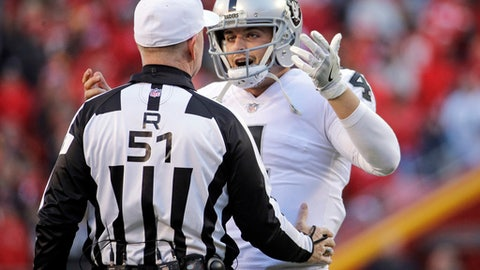 FILE - In this Sunday, Dec. 10, 2017, file photo, Oakland Raiders quarterback Derek Carr (4) talks to referee Carl Cheffers (51) during the second half of an NFL football game against the Kansas City Chiefs in Kansas City, Mo. After falling flat in Kansas City to lose control of the AFC West, the Raiders aim to regroup for the final three games knowing their playoff hopes are slim. (AP Photo/Charlie Riedel, File)