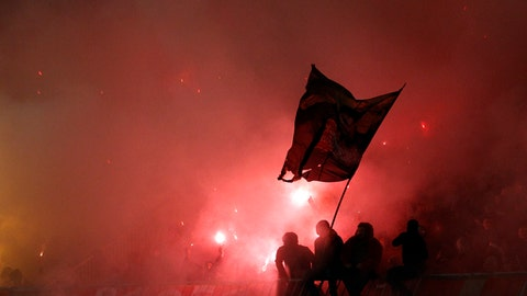 Red Star soccer fans light torches during a Serbian National soccer league derby match between Partizan and Red Star in Belgrade, Serbia, Wednesday, Dec. 13, 2017. (AP Photo/Darko Vojinovic)