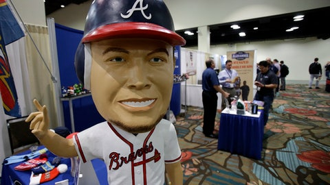 A life size Chipper Jones bobble head doll was among the items available at a trade show at the Major League Baseball winter meetings Wednesday, Dec. 13, 2017, in Orlando, Fla. (AP Photo/John Raoux)