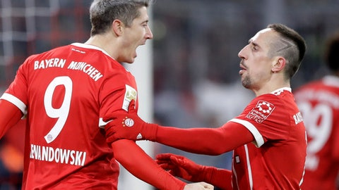 Bayern's Robert Lewandowski , left, celebrates with team mate Franck Ribery after scoring his side's opening goal during the German Soccer Bundesliga match between FC Bayern Munich and 1.FC Koeln in Munich, Germany, Wednesday, Dec. 13, 2017. (AP Photo/Matthias Schrader)