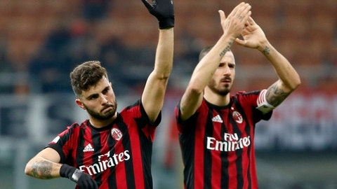AC Milan's Patrick Cutrone, left, and Leonardo Bonucci applaud fans at the end of the Italian Cup soccer match between AC Milan and Hellas Verona, at the Milan San Siro stadium, Italy, Wednesday, Dec. 13, 2017. AC Milan won 3-0. (AP Photo/Antonio Calanni)