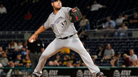 FILE - In this Tuesday, Sept. 19, 2017 file photo, Milwaukee Brewers relief pitcher Anthony Swarzak delivers in the eighth inning of a baseball game against the Pittsburgh Pirates in Pittsburgh. A person familiar with the contract tells The Associated Press that free-agent reliever Anthony Swarzak has reached a deal with the New York Mets, Wednesdaqy, Dec. 13, 2017. (AP Photo/Gene J. Puskar, File)