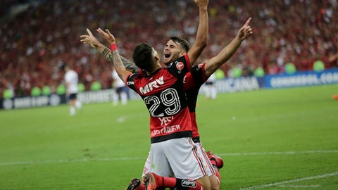 Brazil's Flamengo Lucas Paqueta, 29, and his teammete Felipe Vizeu celebrate after scoring against Argentina's Independiente during the Copa Sudamericana final championship soccer match at Maracana stadium in Rio de Janeiro, Brazil, Wednesday, Dec.13, 2017. (AP Photo/Silvia Izquierdo)