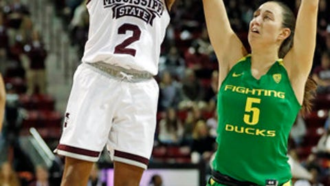 Mississippi State guard Morgan William (2) attempts a shot past Oregon guard Maite Cazorla (5) in the first half of their NCAA college basketball game in Starkville, Miss., Wednesday, Dec. 13, 2017. (AP Photo by Rogelio V. Solis)