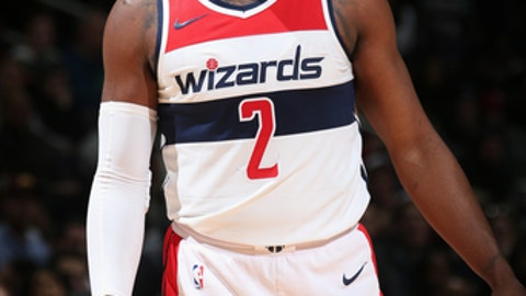 WASHINGTON, DC -  DECEMBER 13:  John Wall #2 of the Washington Wizards looks on during the game against the Memphis Grizzlies on December 13, 2017 at Capital One Arena in Washington, DC. NOTE TO USER: User expressly acknowledges and agrees that, by downloading and or using this Photograph, user is consenting to the terms and conditions of the Getty Images License Agreement. Mandatory Copyright Notice: Copyright 2017 NBAE (Photo by Ned Dishman/NBAE via Getty Images)