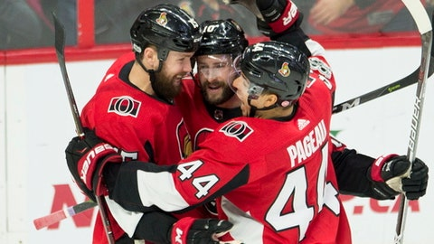 Ottawa Senators left wing Zack Smith, left, celebrates his goal with left wing Tom Pyatt and centre Jean-Gabriel Pageau, right, celebrate a goal during third period NHL action in Ottawa on Wednesday, Dec. 13, 2017. (Adrian Wyld/The Canadian Press via AP)