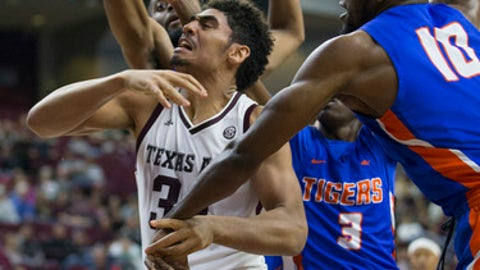 Savannah State center Maricus Glenn (10) knuckles the ball loose from Texas A&M center Tyler Davis (34) during the first half of an NCAA college basketball game Wednesday, Dec. 13, 2017, in College Station, Texas. (AP Photo/Sam Craft)