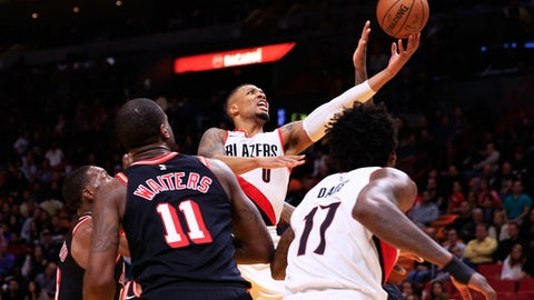 MIAMI, FL - DECEMBER 13:  Damian Lillard #0 of the Portland Trail Blazers shoots against the Miami Heat in the fourth quarter at American Airlines Arena on December 13, 2017 in Miami, Florida. NOTE TO USER: User expressly acknowledges and agrees that, by downloading and or using this photograph, User is consenting to the terms and conditions of the Getty Images License Agreement.  (Photo by Cliff Hawkins/Getty Images)