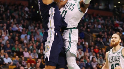 BOSTON, MA - DECEMBER 13:  Kyrie Irving #11 of the Boston Celtics drives to the basket against Trey Lyles #7 of the Denver Nuggets during the second half at TD Garden on December 13, 2017 in Boston, Massachusetts.  (Photo by Tim Bradbury/Getty Images)