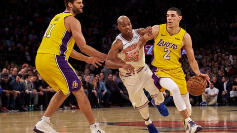 In this Tuesday, Dec. 12, 2017 photo, Los Angeles Lakers' Lonzo Ball, right, brings the ball up court follow by New York Knicks' Jarrett Jack, center, during the first half of an NBA basketball game at Madison Square Garden in New York. (AP Photo/Andres Kudacki)