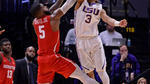 LSU guard Tremont Waters (3) blocks the shot of Houston guard Corey Davis Jr. (5) during an NCAA college basketball game, Wednesday, Dec. 13, 2017, at LSU's Pete Maravich Assembly Center in Baton Rouge, La. (Hilary Scheinuk/The Advocate via AP)