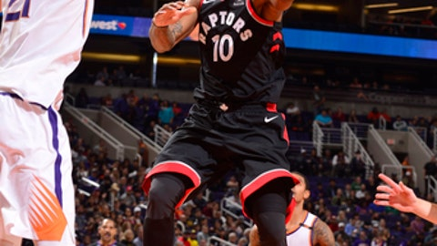 PHOENIX, AZ - DECEMBER 13: DeMar DeRozan #10 of the Toronto Raptors goes to the basket against the Phoenix Suns on December 13, 2017 at Talking Stick Resort Arena in Phoenix, Arizona. NOTE TO USER: User expressly acknowledges and agrees that, by downloading and or using this photograph, user is consenting to the terms and conditions of the Getty Images License Agreement. Mandatory Copyright Notice: Copyright 2017 NBAE (Photo by Barry Gossage/NBAE via Getty Images)