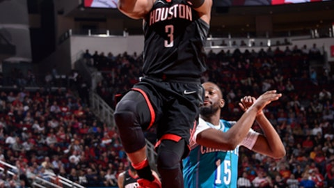 HOUSTON, TX - DECEMBER 13:  Chris Paul #3 of the Houston Rockets goes to the basket against the Charlotte Hornets on December 13, 2017 at the Toyota Center in Houston, Texas. NOTE TO USER: User expressly acknowledges and agrees that, by downloading and or using this photograph, User is consenting to the terms and conditions of the Getty Images License Agreement. Mandatory Copyright Notice: Copyright 2017 NBAE (Photo by Bill Baptist/NBAE via Getty Images)