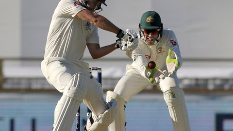 England's Dawid Malan, left, plays a shot in front of Australia's Tim Paine during their Ashes cricket test match in Perth, Australia, Thursday, Dec. 14, 2017. (AP Photo/Trevor Collens)