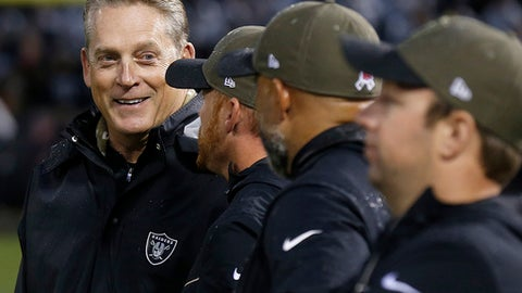 FILE - In this Nov. 26, 2017, file photo, Oakland Raiders head coach Jack Del Rio, left, smiles as he talks to assistants during the second half of an NFL football game against the Denver Broncos in Oakland, Calif. The Raiders face the Dallas Cowboys on Sunday, Dec. 17. (AP Photo/D. Ross Cameron, File)