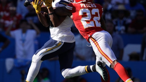FILE - In this Sept. 24, 2017 file photo, Kansas City Chiefs cornerback Marcus Peters, right, breaks up a pass intended  for Los Angeles Chargers wide receiver Tyrell Williams during the second half of an NFL football game in Carson, Calif.  The Chargers and Chiefs understand their showdown at Arrowhead Stadium on Saturday, Dec. 16  will not decide the AFC West, even though they're tied atop the division with three games to go. (AP Photo/Jae C. Hong, File)
