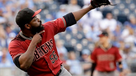 FILE - In this Oct. 1, 2017, file photo, Arizona Diamondbacks relief pitcher Fernando Rodney celebrates after a baseball game against the Kansas City Royals in Kansas City, Mo. A person familiar with the negotiations says Rodney and the Minnesota Twins have agreed to a $4.5 million, one-year contract. The person spoke on condition of anonymity to The Associated Press on Thursday, Dec. 14, 2017, because the agreement had not yet been announced. Rodney, who turns 41 on March 18 and will be in his 16th major league season, is known for firing an imaginary arrow to celebrate the final out of wins. (AP Photo/Charlie Riedel, File)
